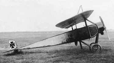 "The type of plane flown by Warnesford against the Zeppelin WW1: A captured Moran-Saulnier Type l (note the German insigna). It was a ""parasol"" monoplane (a single-wing above the fuselage)."