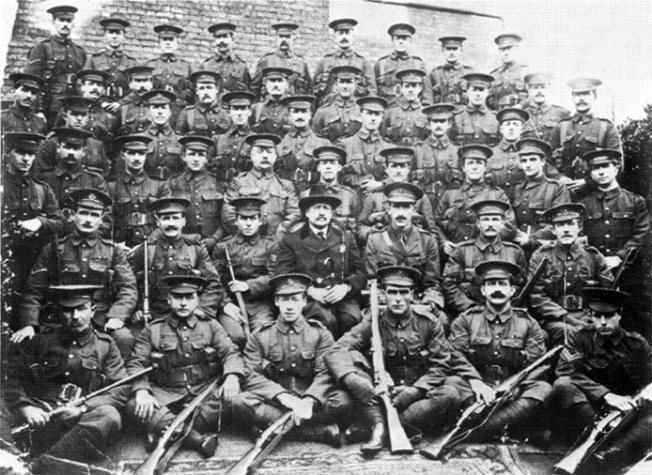 Men of the original Rhodesian Platoon of the King's Royal Rifle Corps (during the course of World War I, there were several such platoons). Taken in November 1914 at the KRRC training depot at Sheerness, Kent, before the platoon went to the Western Front. In the centre of the second row from the front sit the 16th Marquess of Winchester and the platoon's commanding officer, Captain John Banks Brady. The majority of the men pictured were killed in action, with most of the others severely wounded.