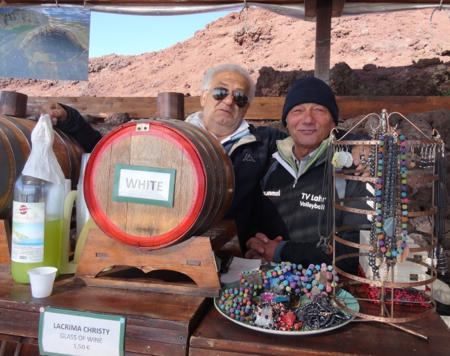 'shoulder-shrugging optimists' at their stall on the edge of the crater