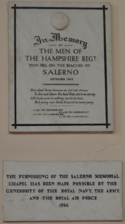 This plaque is inside the church above a book listing the names of those who died at Salerno