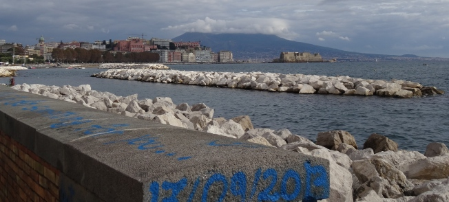 Vesuvius, head in the clouds, watches the Bay of Naples