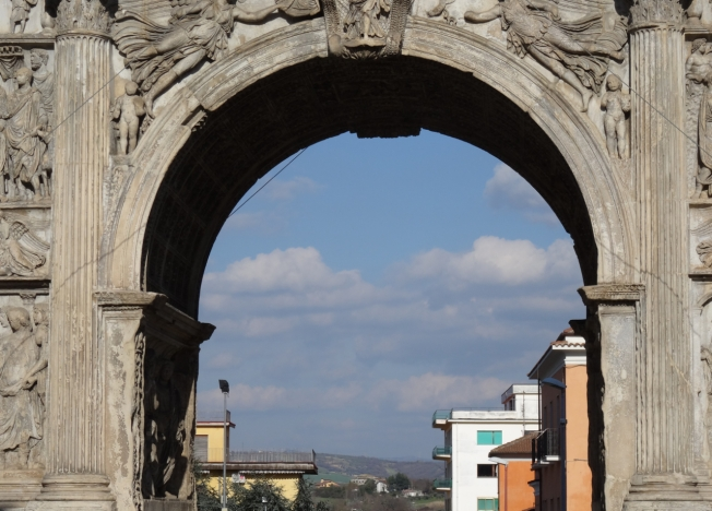View through Trajan's Arch to modern Benevento and beyond