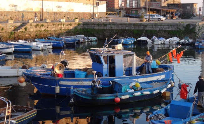 Fishing boat in the old harbour of Pozzuoli