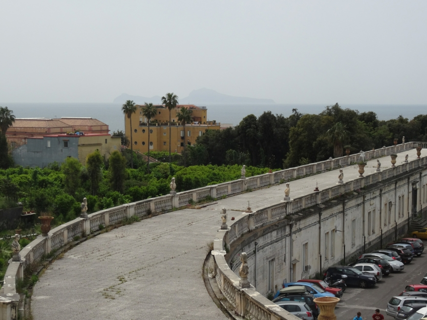 Statued promenades, like great wings, sweep out towards the sea and Capri at the Palazzo Reale di Portici