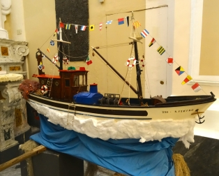 The model fishing boat inside the church in Cetara
