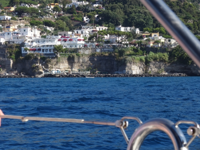 Sailing past the steep sides of Ischia