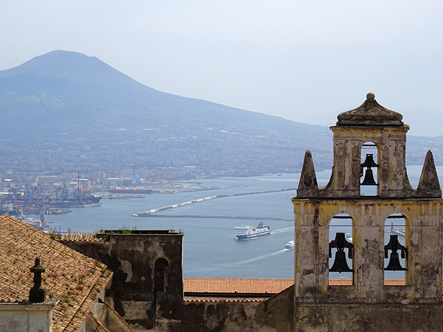 Photograph by Eliza Fraser-Mackenzie: view from Castel Sant'Elmo across the Bay of Naples to Vesuvius with the bells of the 'certoso di San Martino' in the foreground.