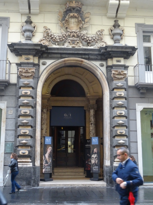 The entrance to the Palazzo Zevallos Stigliano on the Via Toledo in Naples, Italy - home to the painting thought to be Caravaggio's last masterpiece