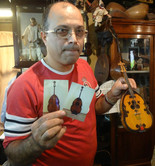 Luthier Salvatore Masiello with tiny replicas of the stringed instruments that have meant so much to Naples and the mandolin