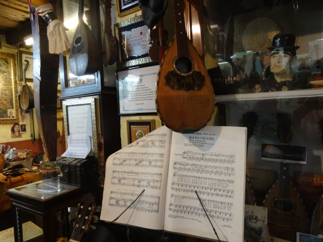 Crowded 'Bottega del Mandolino' in Naples, Italy