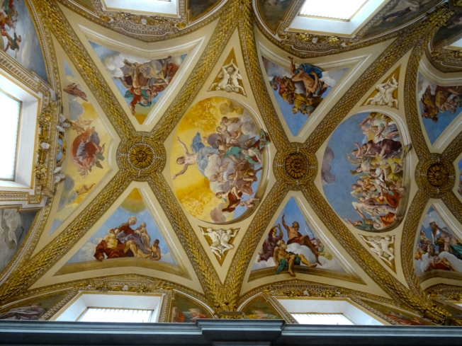 The painted ceiling of the church in the Monasterio di San Martino in Naples, Italy