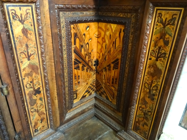 Detail of inlay work in a wooden corner cupboard in the Certosa di San Martino in Naples, Italy