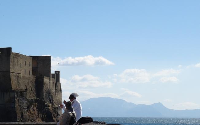 Pulcinella by the Castel dell'Ovo in Naples, Italy