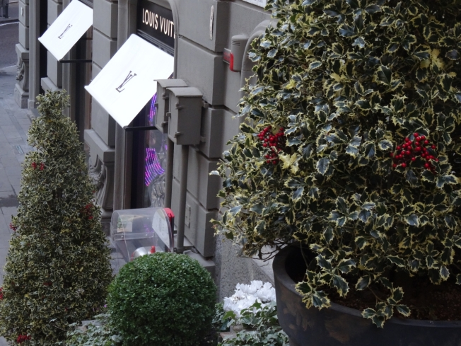 Louis Vuitton and the steps that lead up from the store in Via dei Mille in Naples, Italy