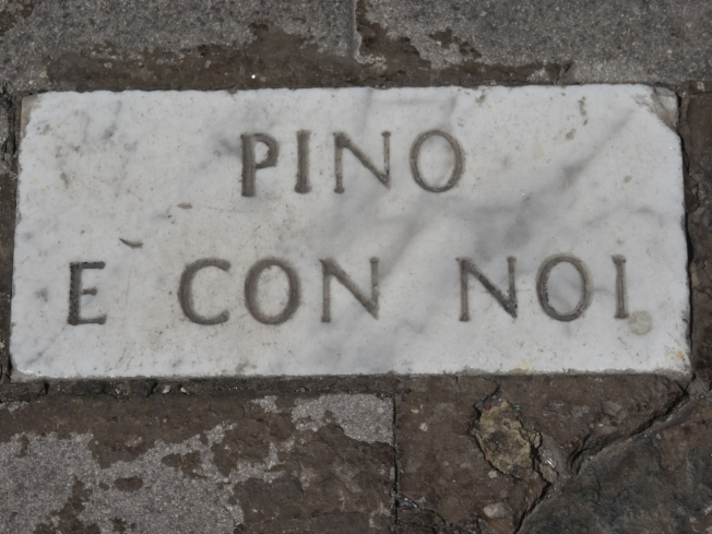 Memorial to Pino Daniele - one of the pavement stones that carry his name. This one is along the seafront in Naples, Italy
