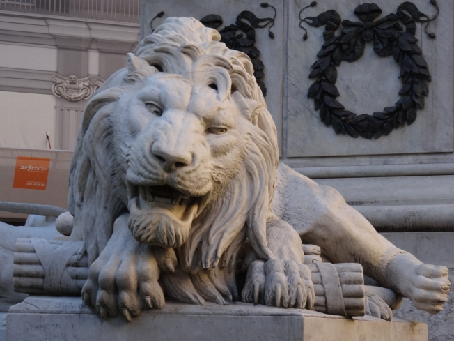 One of the four lions in the Piazza dei Martiri