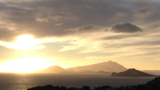 View from Parco Virgiliano towards Capo Miseno and on to the islands of Procida and Ischia. In the Aeneid the trumpeter Misenus dies off Capo Miseno which then took his name.