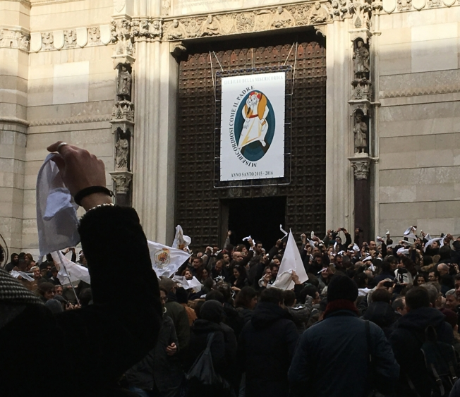 White handkerchiefs wave at the March demonstration on the steps of the Duomo in Naples, Italy