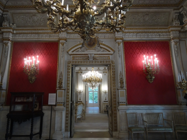 The red room was commissioned by Carl Mayer von Rothschild. Decoration begun by Claret from Paris, and was completed, after the dismissal of Claret, by Gaetano Genovese.
