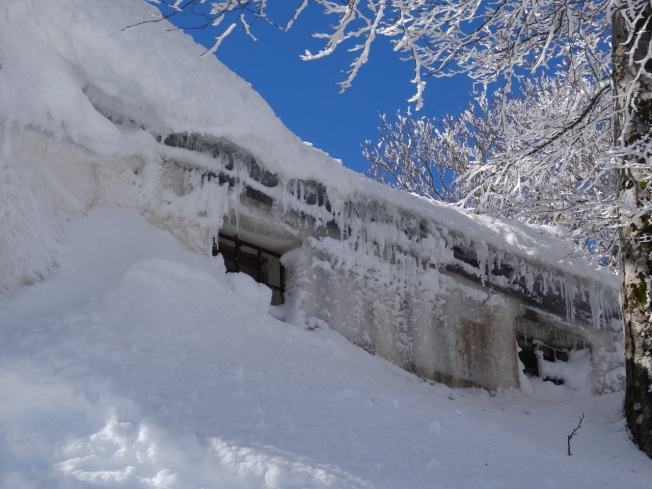 Ice-covered hut at the top of the slopes at Lago Laceno , near Avellino in Italy