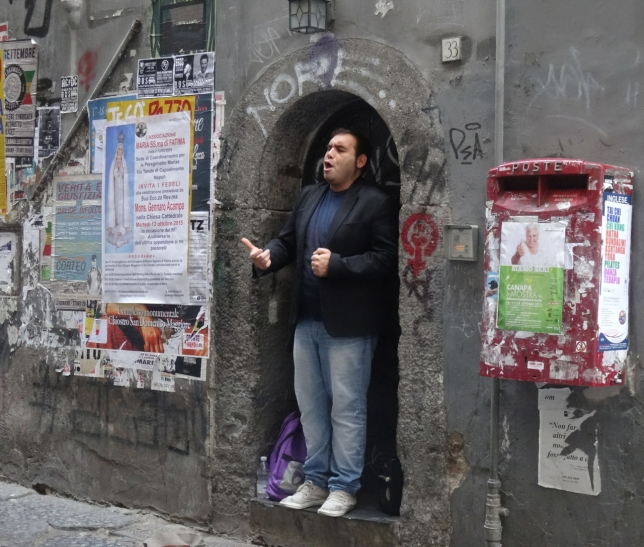 A busker in Naples, Italy