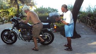Michael Rae and his Honda motorbike in Naples, Italy