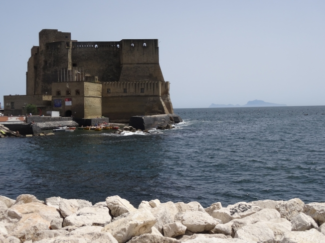 Castel dell'Ovo in Naples, Italy with Capri in the background