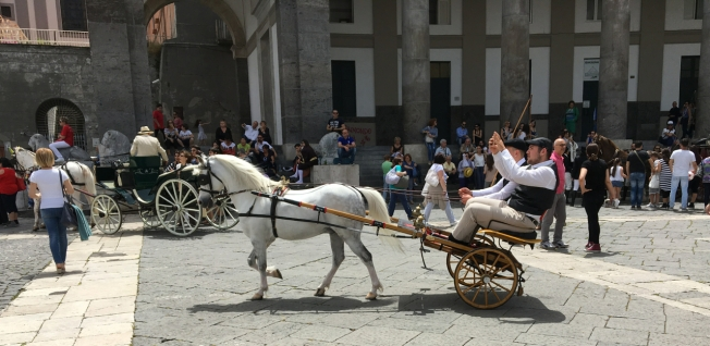 Parade of carriages in the Piazza del Plebiscito in Naples, Italy