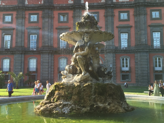 The freshly cleaned fountain at the many-windowed art museum of Capodimonte in Naples, Italy