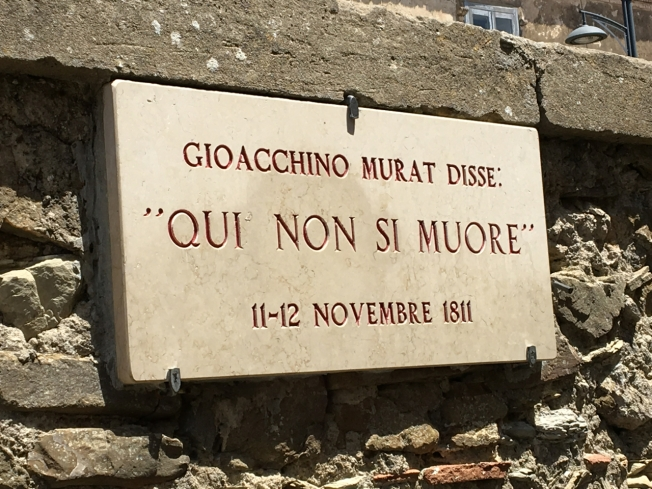 "Plaque on the wall in Castellabate quoting Gioacchino Murat: ""Here one does not die."""