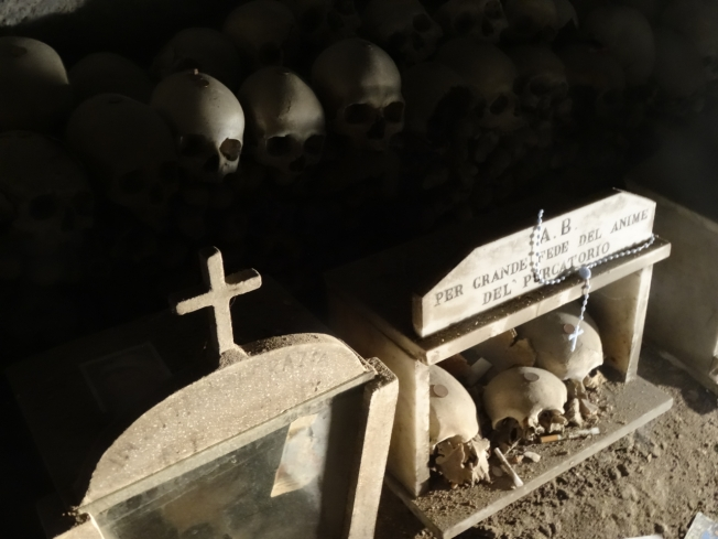 Skulls singled out for particular attention in the Cimitero delle Fontanelle in Naples, Italy
