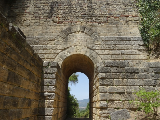 The Porta Rosa in the archaeological site of Velia in Cilento, Italy. It was built in the fourth century BC and buried soon afterwards by some form of landslide. It was only rediscovered in 1964.