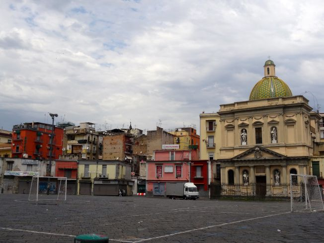 The Piazza del Mercato in Naples Italy - the church behind the football posts is called Santa Croce e Purgatorio and has been closed since the earthquake in 1980. This is the church that first marked the spot where Conradin was killed.
