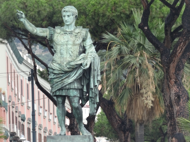 Statue of Caesar on the seafront in Naples Italy