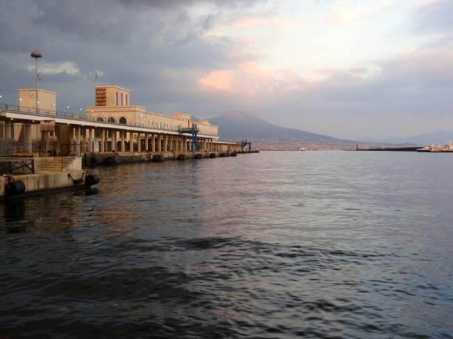 Evening arrival back at the Molo Beverello in Naples, Italy