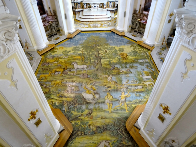 The hand-painted ceramic floor in the church showing Adam and Eve's expulsion from the garden of Eden (1761)