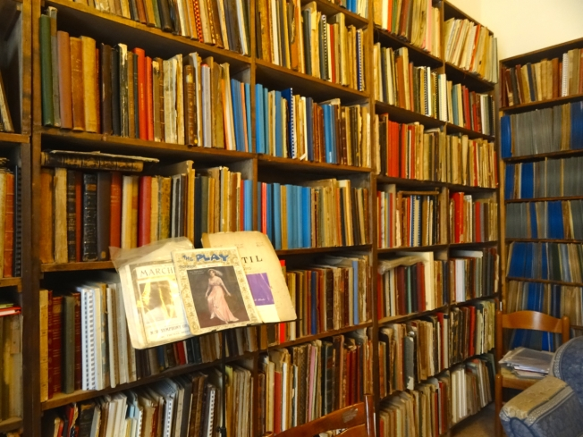 A small section of bookcase carrying part of Michael Aspinall's collection of musical scores and literature