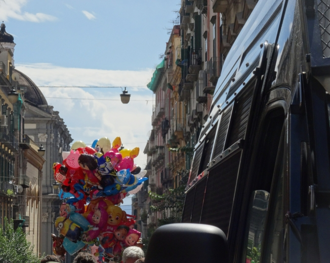 Riot vans and balloons - the Feast of San Gennaro in Naples, Italy
