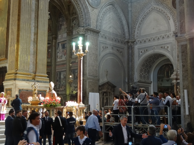 The camera crews inside the cathedral in Naples, Italy on 19 September 2016