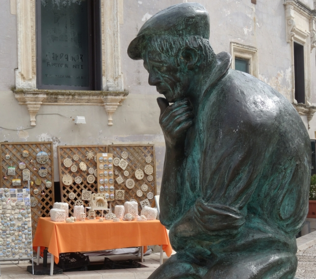 Statue in the square that overlooks the old cave houses in Matera, In Basilicata in Italy