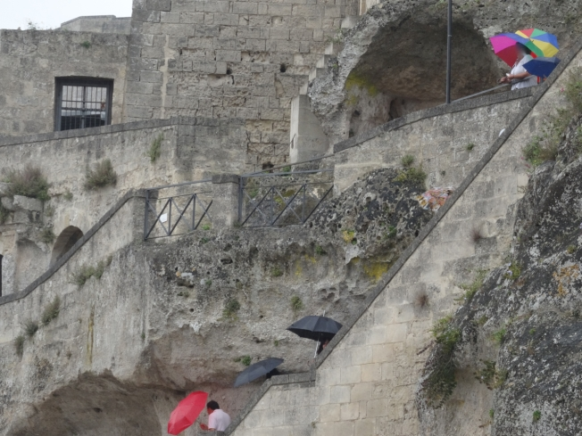 A sprinkle of tourists in Matera in Basilicata in Italy