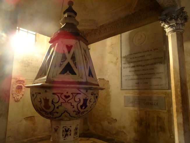 The baptismal font in the Cathedral of San Cataldo in Taranto in Puglia, Italy