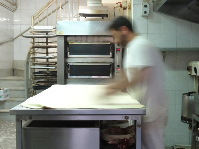 A baker at work in Naples, Italy