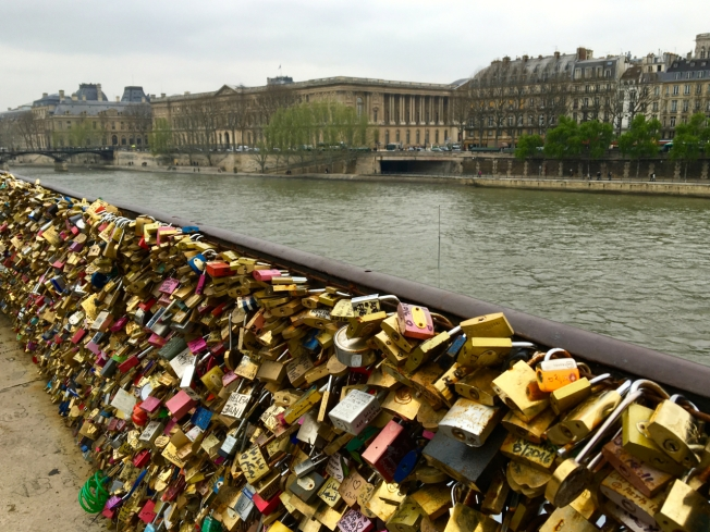 Love locks on a bridge over the Seine in Paris, France