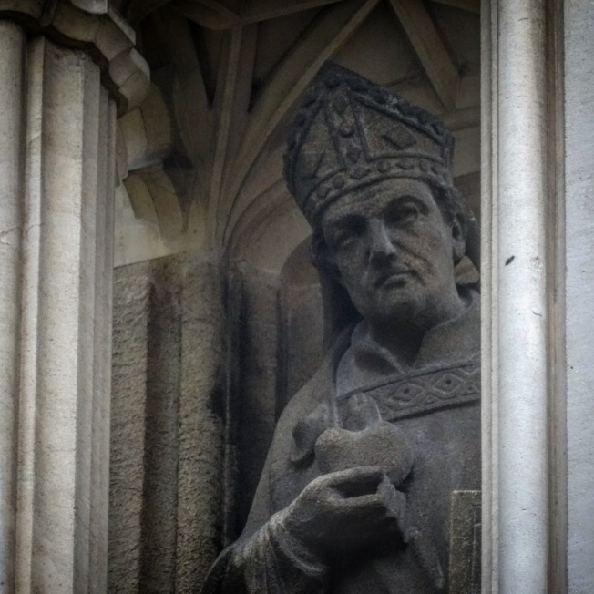 Carving on the outside of Gloucester Cathedral in England