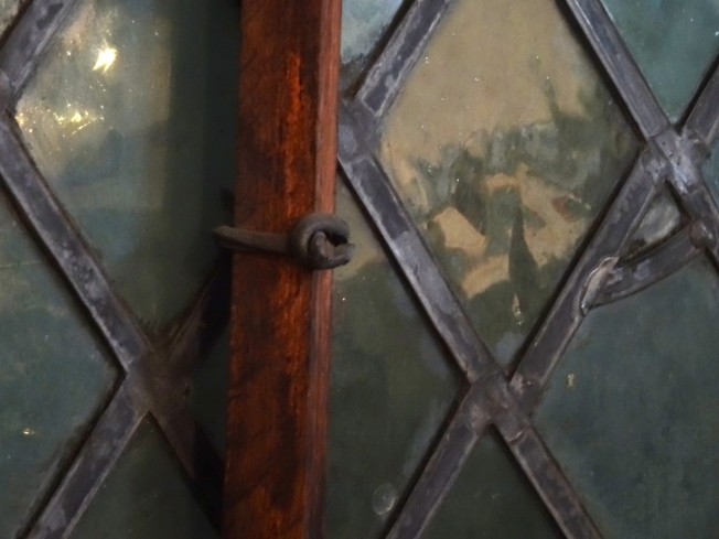 Detail from an original Tudor window in Gloucester, England