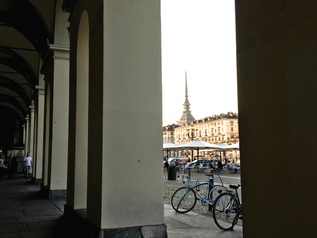 One of the covered walkways that run down either side of huge Piazza Vittorio Veneto in Turin, Italy