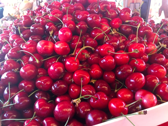 Cherries for sale in Porto Palazzo market in Turin, Italy