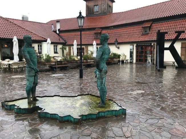 Czech sculptor's work 'Proudy' outside the Kafka Museum in Prague